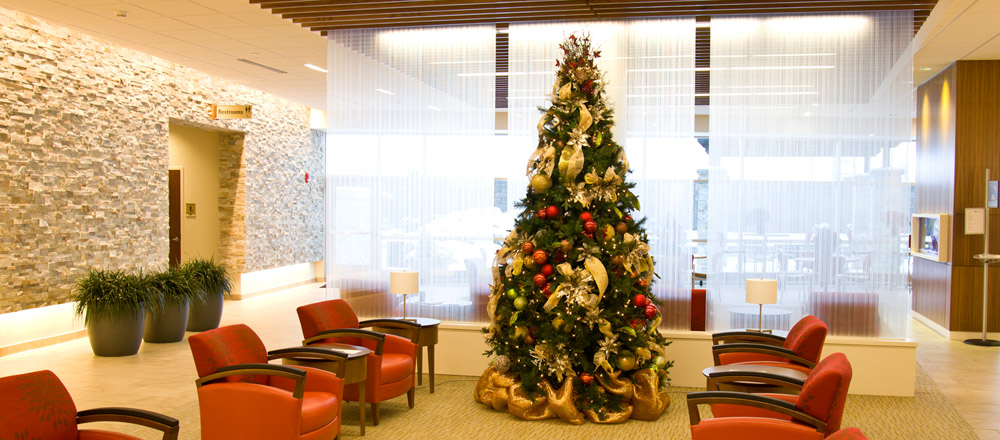 Christmas tree in lobby of healthcare facility.