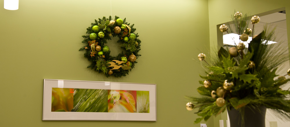 Wreath and counter display match surrounding office design.