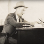BT Engledow, founder of Engledow Group, sitting at his desk (circa 1930s)
