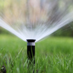 Sprinkler system watering the lawn