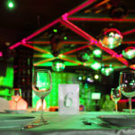 Tables setup for office party with neon red and green lights