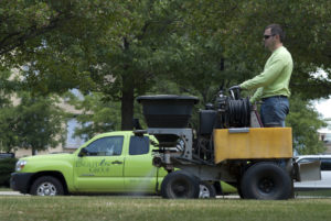 Engledow employee spraying for weeds