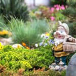 Gnome statue sitting in a beautiful garden